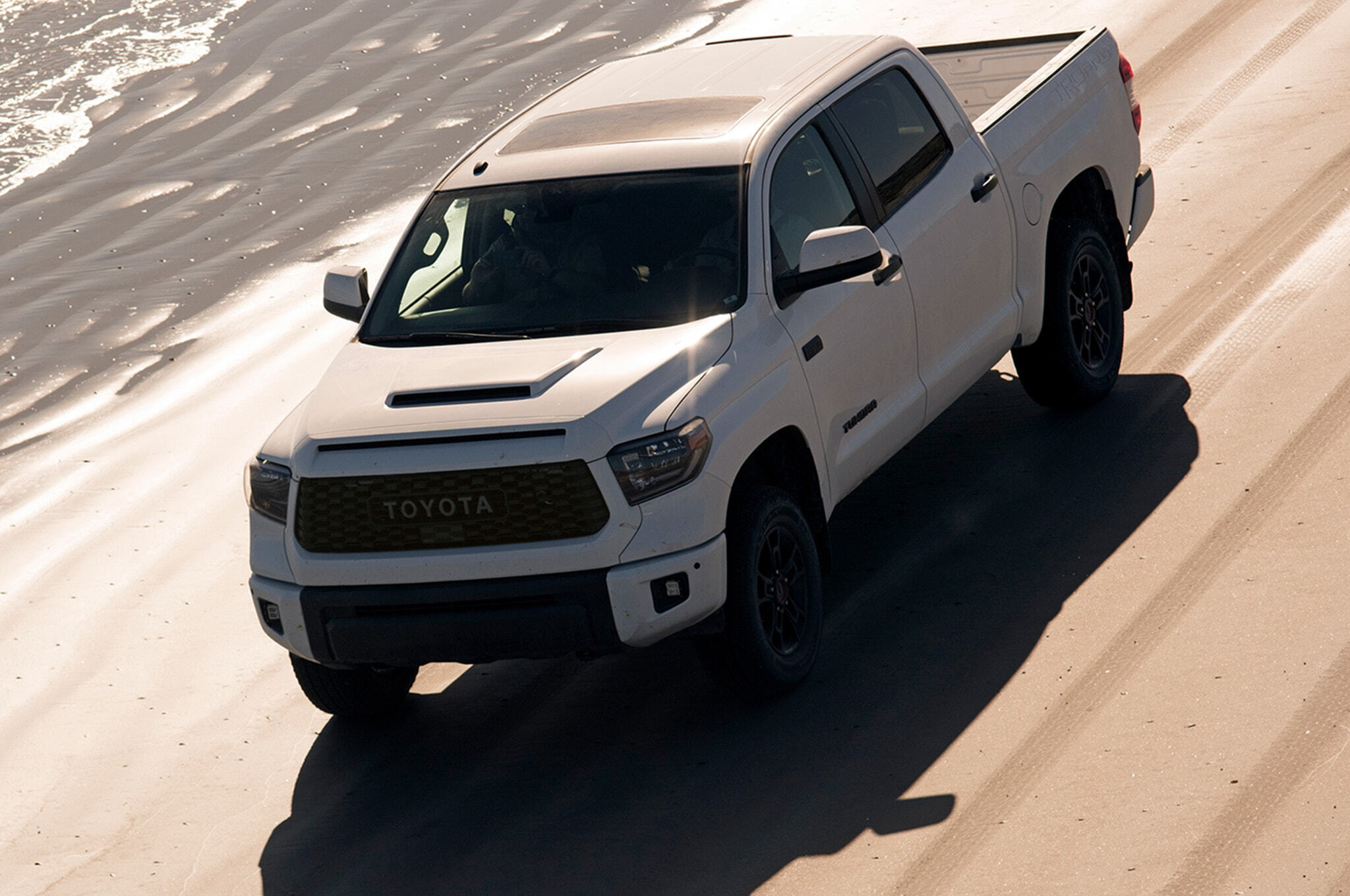2019-Toyota-Tundra-TRD-Pro-front-three-quarter-in-motion-02